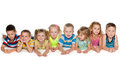 Eight children joyful are lying on the floor on a white background Royalty Free Stock Photos