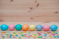 Eight easter eggs pastel colored on the wooden with candle vintage background Royalty Free Stock Photo