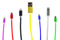 Eight multicolored usb cables, with connectors for micro and for iphone or ipad, stand upright, on a white background. Th