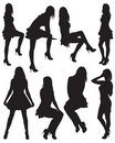 Eight silhouettes of beautiful girls Stock Photos