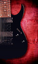 Eight strings guitar black electric string painted metal background Stock Photography