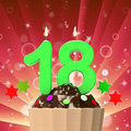 Eighteen candle on cupcake means eighteenth meaning birthday cake or celebration Stock Images