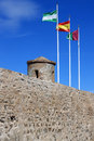 Eighth century fortress castillo de gibralfaro flags raised above ancient called located in malaga andalusia in the costa del sol Stock Photography