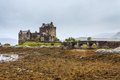 Eilan Donan castle at low water in Scotland Stock Photography