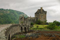 Eilean donan castle on a cloudy day low tide highlands scotland uk Stock Photography