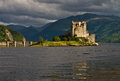 Eilean donan castle famous and dramatically situated on the north west coast of the highlands of scotland was the seat of the clan Stock Photos
