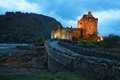 Eilean donan castle illuminated at dusk located in the highlands scotland uk Royalty Free Stock Image