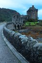 Eilean donan castle at low tide at dusk in scotland uk Stock Images