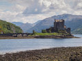 Eilean donan castle scottish highlands view of on loch duich with bridge leading out to the mediaeval the lays at the meeting Stock Photos