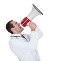 El doctor de sexo masculino Shouting In Megaphone Imágenes de archivo libres de regalías