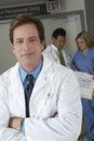 El doctor standing arms crossed Foto de archivo