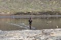 El sod crater lake ethiopia man bringing salt take bottom crater lake hard work Royalty Free Stock Photo