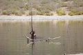 El sod crater lake ethiopia man working inside lake to take salt bottom crater lake Royalty Free Stock Photography