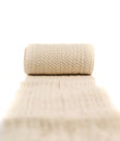 Elastic ace compression bandage warp unwrapped over white background shallow depth of field Royalty Free Stock Images