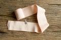 Elastic bandage on wooden background Stock Photo