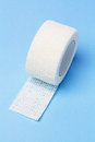 Elastic medical bandage white on blue background Royalty Free Stock Image