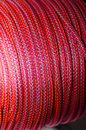Elastic ropes close up detail of a reel of red Stock Image