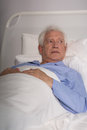 Elder man in hospital bed Royalty Free Stock Photo