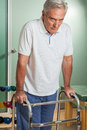 ELder man using a walker Royalty Free Stock Photo