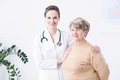 Elder woman with her doctor Royalty Free Stock Photo