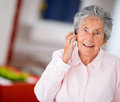 Elder woman on the phone talking a mobile Stock Photos