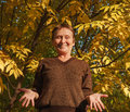 Elder woman shrug shoulder on the background of colorful leaf photo took in moscow russian Stock Image