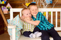 Elder and younger brothers on bench kids sitting indoors Stock Images