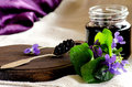 The elderberry jam and a bouquet of violets Royalty Free Stock Photo