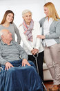Eldercare nursing service at home for senior citizen couple Stock Images