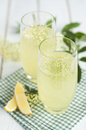 Elderflower cordial in old style glasses Royalty Free Stock Photography