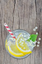Elderflower juice with lemon on old table Royalty Free Stock Image