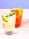 Elderflower, orange cocktails on blue background Royalty Free Stock Photo