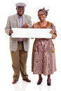 Elderly african couple banner cheerful holding blank giving thumbs up Royalty Free Stock Photography