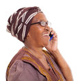 Elderly african woman phone happy talking on smart on white background Royalty Free Stock Images