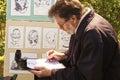 Elderly artist draws cartoons burbiskis lithuania may on holiday in burbiskis radvilisis lithuania Stock Photos