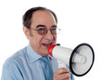 Elderly businessman making an announcement Royalty Free Stock Photos