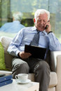 Elderly businessman sitting in armchair Royalty Free Stock Photo