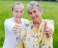 Elderly care happy women satisfied with her caretaker Stock Image