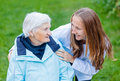 Elderly care portrait of women and her caregiver Stock Photos