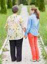 Elderly care walking and telling stories on the nature Stock Photography