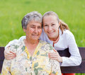 Elderly care women with her caretaker in the nature Stock Images