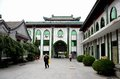 Elderly chinese muslim man walks in entrance courtyard of mosque beijing china october an religious cap the a islamic the capital Stock Photos