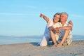 Elderly couple on beach the enjoy the sea breeze Royalty Free Stock Photo