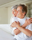 Elderly couple on bed looking away in thought Royalty Free Stock Photography