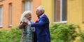 Elderly couple dancing on the street. Waltz outdoors. True love. Royalty Free Stock Photo