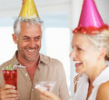 An elderly couple enjoying in a birthday party Stock Photo