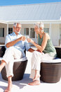 Elderly couple enjoying a glass of champagne Stock Photos