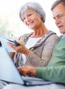 Elderly couple extracting data from the internet Stock Photo