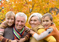 Elderly couple and grandchildren portrait of happy beautiful together resting Royalty Free Stock Photography
