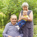 Elderly couple with granddaughter Stock Photography